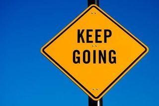 Keep on going sign